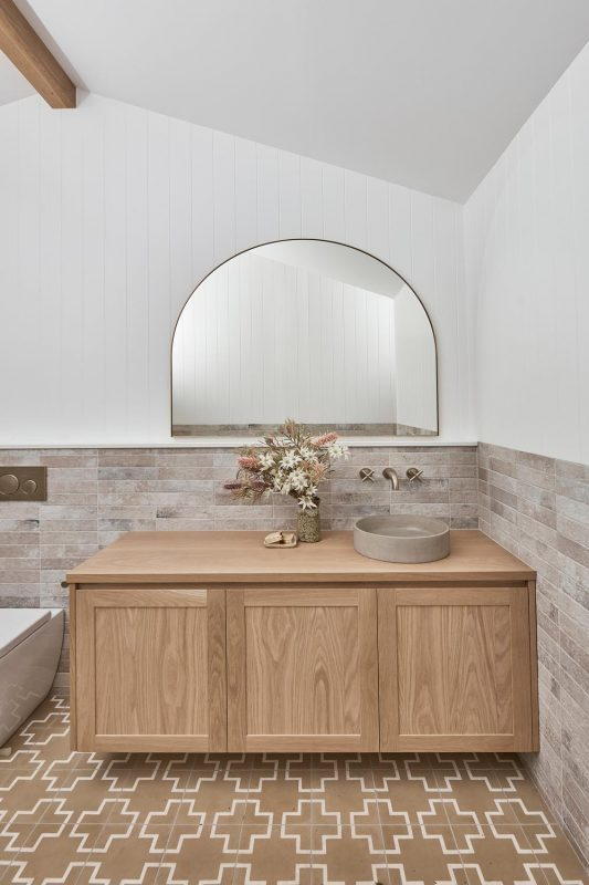 Pacific wall hung vanity with shaker profile doors, Archie 1200 mirror and Slabshapers Basin